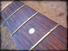 worn guitar frets